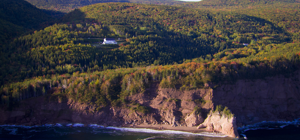 Nestled in the Cape Breton Highlands along the rugged Atlantic coastline